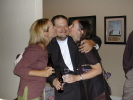 Holly Hassinger McVay and Jenny Estes Varma smooching with Mike Hillerby