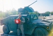 Chris Fears showing OU love from Iraq.